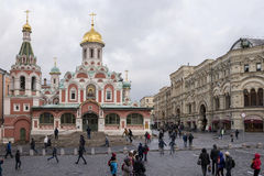 Tourists walk on Red Square and take pictures for memory Stock Photos