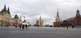 Tourists walk on Red Square and take pictures for memory Royalty Free Stock Image