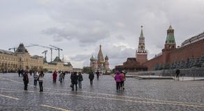 Tourists walk on Red Square and take pictures for memory Stock Photography