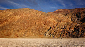 Tourists Walk on the Salt Flats at Badwater Basin in Death Valle Royalty Free Stock Photos