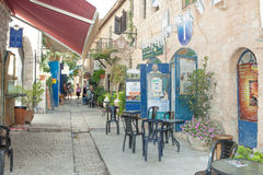 Tourists walk by shops and art galleries in Safed. S old city alleys Royalty Free Stock Photo
