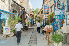 Tourists walk by shops and art galleries in Safed. S old city alleys Stock Photo