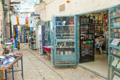 Tourists walk by shops and art galleries in Safed. S old city alleys Stock Photography
