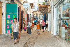 Tourists walk by shops and art galleries in Safed. S old city alleys Stock Photos