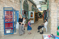 Tourists walk by shops and art galleries in Safed. S old city alleys Royalty Free Stock Images