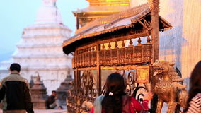 Tourists walk and spin prayer wheels at Monkey Temple Stock Images