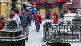 Tourists walk and spin prayer wheels at Monkey Temple. Royalty Free Stock Photos