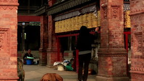 Tourists walk and spin prayer wheels at Monkey Temple Stock Photography