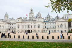 Tourists walk on the square of Horse Guards royalty free stock image