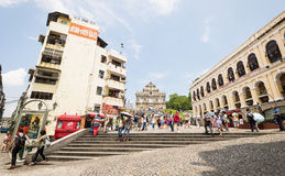 Tourists walk on the square near the Ruins of St. Peter's in september 2013 in Macau. Royalty Free Stock Photography