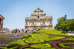 Tourists walk on the square near the Ruins of St. Peter's in september 2013 in Macau. Stock Photography