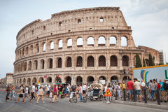 Tourists walk on the street near Colosseum in Rome Royalty Free Stock Photos