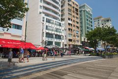 Tourists walk by the street in Stanley town in Hong Kong, China Stock Photo