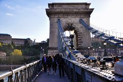 The Széchenyi Chain Bridge in Budapest, Hungary. Tourists walk on the Széchenyi Chain Bridge in Budapest, Hungary royalty free stock photography