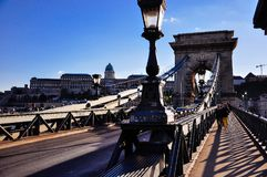 The Széchenyi Chain Bridge in Budapest, Hungary. Tourists walk on the Széchenyi Chain Bridge in Budapest, Hungary royalty free stock photos