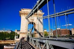 The Széchenyi Chain Bridge in Budapest, Hungary. Tourists walk on the Széchenyi Chain Bridge in Budapest, Hungary royalty free stock images