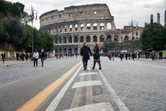 Tourists walk to Colosseum in Rome Stock Images