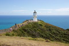 Tourists walk to lighthouse at Cape Reinga, Northland, New Zealand Royalty Free Stock Photos