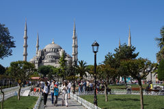 Tourists walk towards  Sultan Ahmet Camii Stock Photo