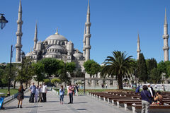 Tourists walk towards  Sultan Ahmet Camii Stock Images