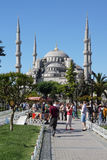 Tourists walk towards  Sultan Ahmet Camii Stock Image