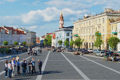 Tourists walk by the Town Hall square in Vilnius, Lithuania. Stock Photo