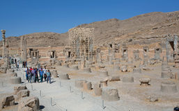Tourists walk trough ruins of city Persepolis Royalty Free Stock Photography