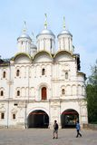Tourists walk by the Twelve apostles church in Moscow Kremlin. Stock Photos