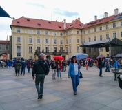 Tourists walk with umbrellas in Prague Castle in rainy weather. stock photography
