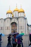 Tourists walk under umbrellas. Moscow Kremlin. Stock Photos
