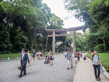 Tourists walk at the way path to Meiji shrine, Tokyo, Japan. Tokyo -JUL 17: Tourists walk at the way path to Meiji shrine, Tokyo, Japan. This shrine is dedicated stock images