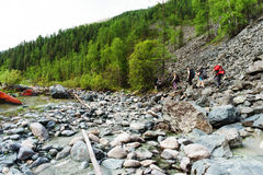Tourists walk in the wild forest on the rocks. Respublic Altai, Russia Stock Photo