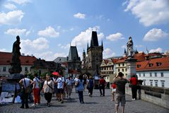 Tourists walking along Charles Bridge in Prague,Czech Republic Imagen de archivo