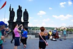 Tourists walking along Charles Bridge in Prague,Czech Republic Royalty Free Stock Images