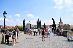 Tourists walking along Charles Bridge in Prague,Czech Republic Stock Images