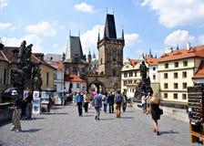 Tourists walking along Charles Bridge in Prague,Czech Republic Stock Photos