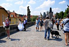 Tourists walking along Charles Bridge in Prague,Czech Republic Royalty Free Stock Photography