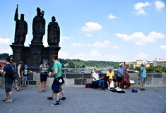 Tourists walking along Charles Bridge in Prague,Czech Republic Royalty Free Stock Images