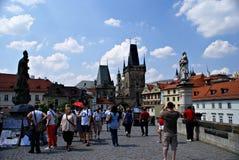 Tourists walking along Charles Bridge in Prague,Czech Republic Stock Image