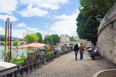 Tourists walking along the embankment of the Seine, Paris Stock Images