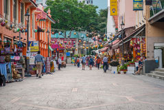 Tourists walking along little India district in Singapore Stock Images