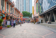 Tourists walking along little India district in Singapore Royalty Free Stock Image