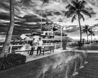 Tourists walking along Mallory Square at sunset, Key West.  Stock Photo