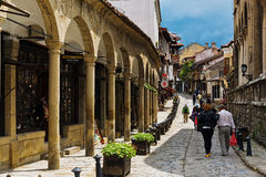 Tourists walking along the old town street of Veliko Tarnovo, Bu Stock Image