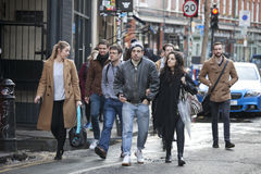 Tourists are walking along Oxford Street, intending to do shopping Royalty Free Stock Photo