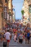A tourists walking along the Republic street of Valletta, Malta Stock Image