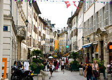 Chambery, France. Tourists walking along a street of the old city centre of Chambery, France Stock Photos