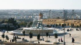 Tourists walking along Triton Square in Valletta, Malta. stock video footage