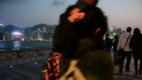 Tourists are walking along the Waterfront. The Avenue of Stars is located along the Victoria Harbour waterfront in Tsim Sha Tsui, Hong Kong stock footage