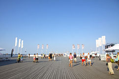 Tourists walking along the wooden pier in Sopot, Poland Royalty Free Stock Image